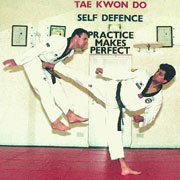Grandmaster Vohra 4rth Dan demonstrating side kick with Derry McCourt 3rd Dan 1997